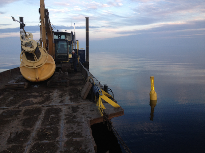 Barge Collecting Weather Buoy